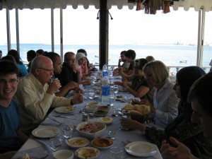 Bruce Lohof, director of Egypt's Fulbright Commission on far left, and others eating