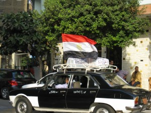 Taxis driving around with Egyptian Flag
