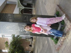 Ivy and Maya at CAC statue in front of Fine Arts Building